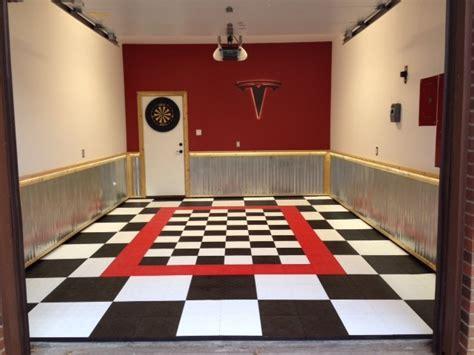 home garage workshop with racedeck garage flooring wall tesla home garage with racedeck garage flooring modern