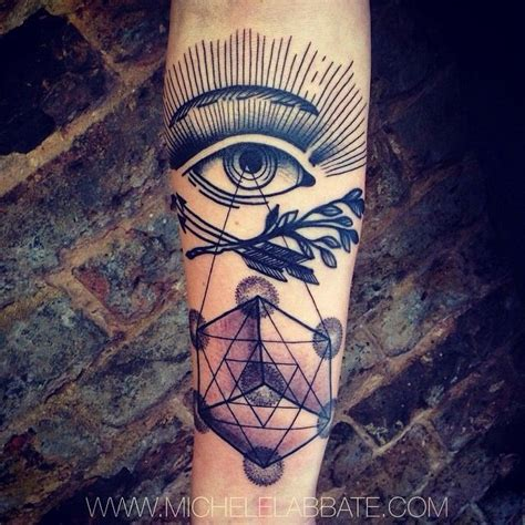 geometric tattoo eye lower arm ink all seeing eye crossed arrows branches