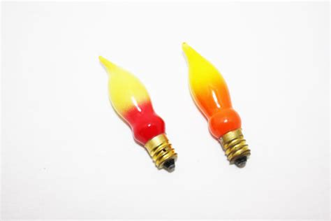vintage christmas light bulbs flame light bulbs yellow