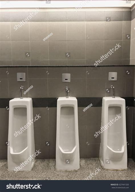 men s bathroom design row outdoor urinals men public toiletcloseup stock photo