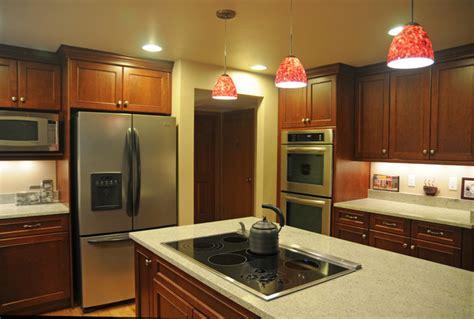 u shaped kitchen transitional kitchen twin companies u shape kitchen with red pendant lighting over island