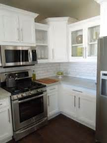 white kitchen cabinets with stainless appliances 17 best ideas about kashmir white granite on pinterest