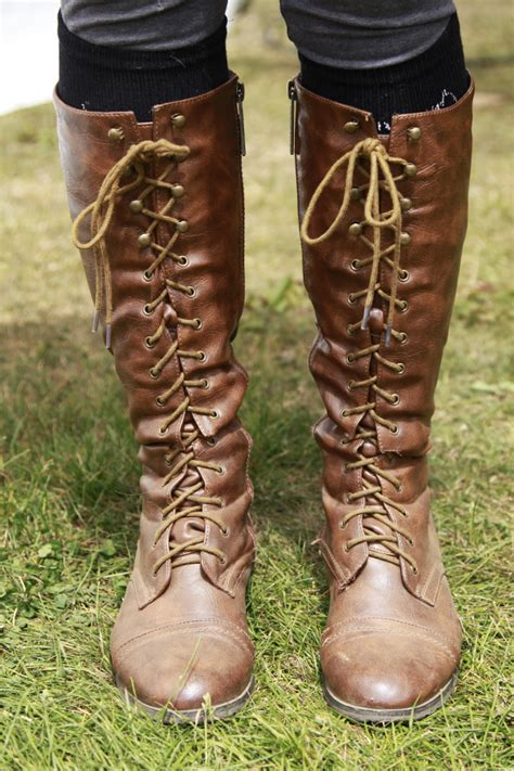 brown knee high lace up boots on the hunt