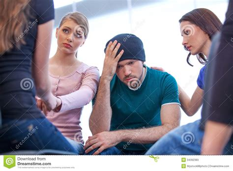 how to comfort a crying man young comforting a man stock photos image 34392383