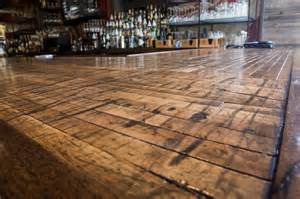close up of reclaimed boxcar plank bar top rustic home bar charleston by reclaimed