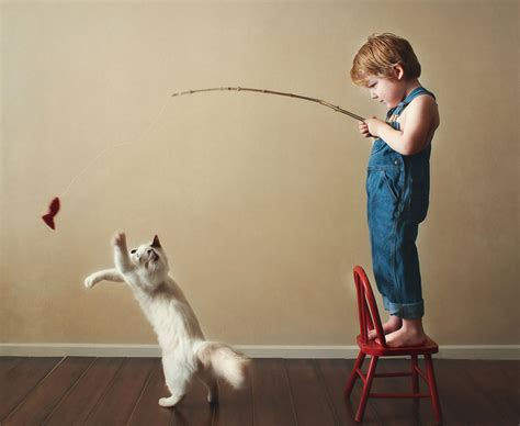 perspective are kids the advertisers shortcut to success 20 heartwarming photos of kids playing with their cats