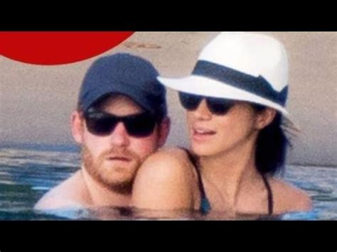 prince harry and meghan markle kissing and cuddling at