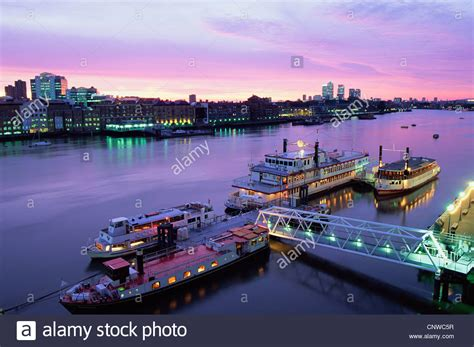 thames river boat canary wharf england london night view of boats on the thames river