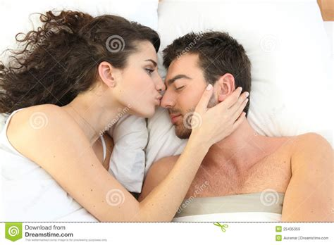 kissing in the bed couple kissing in bed royalty free stock images image 25435359