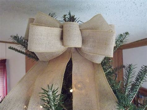how to place burlap bow and burlap streamers on christmas tree burlap tree topper with streamers diy bow front door decor