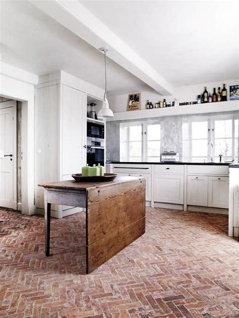 herringbone brick floor in a modern kitchen the new