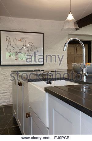 raj s kitchen with belfast sink black wall and base units white belfast sink in fitted unit below fitted wall