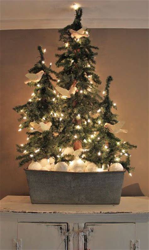 christmas tree forest in an old galvanized tub bottled