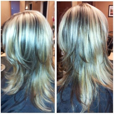 blonde hair with dark chunks light blonde highlights with dark brown peek a boo chunks