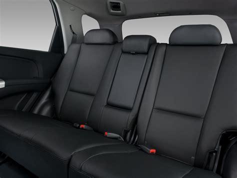 how cars run 2009 kia sportage seat position control 2008 kia sportage kia midsize suv review automobile magazine