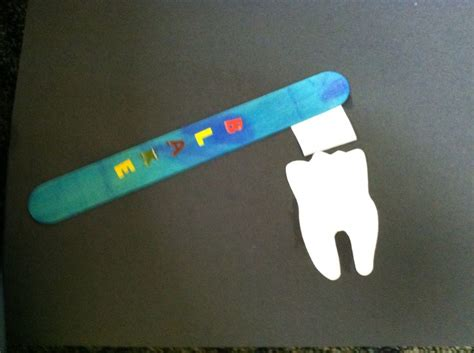 How To Make Canes Out Of Paper - dental day craft tooth brush made out of popsicle sticks
