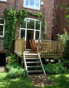 Decking Ideas For Small Gardens Decking Designs For Small Gardens