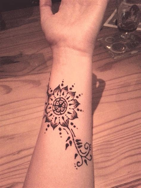 henna flower tattoos 34 awesome wrist flower tattoos