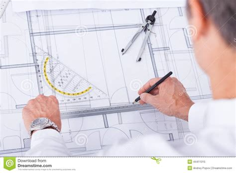 male architect with digital tablet studying plans in male architect stock photo image 44411315