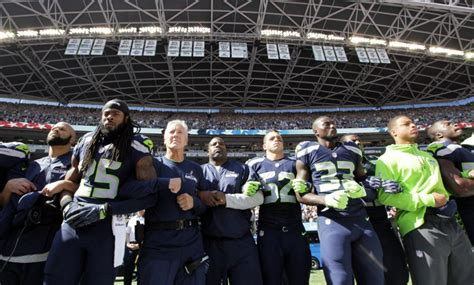football link seahawks link arms during anthem before nfl opener