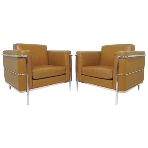 pair of leather lounge chairs by cartwright in manner