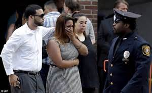 mourners react after exiting mclaughlin funeral home