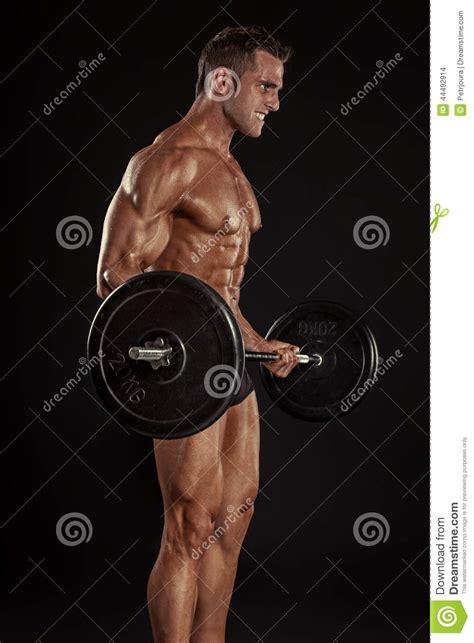 muscular bodybuilder guy  exercises  big dumbbell