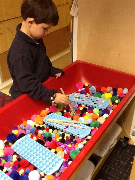 sensory table for toddlers playfully learning sensory table idea pom poms