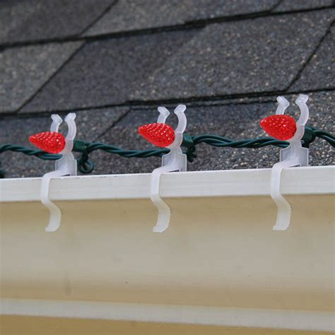 christmas light gutter hangers how to hang lights on gutters