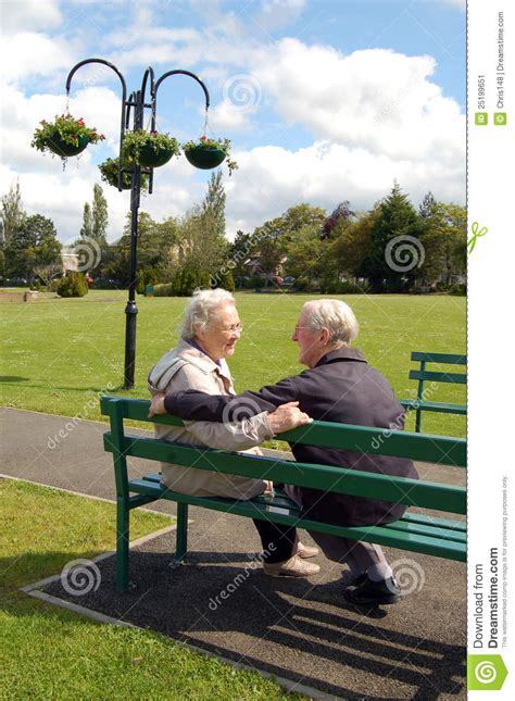 sitting in a park bench senior couple sitting on a park bench stock image image