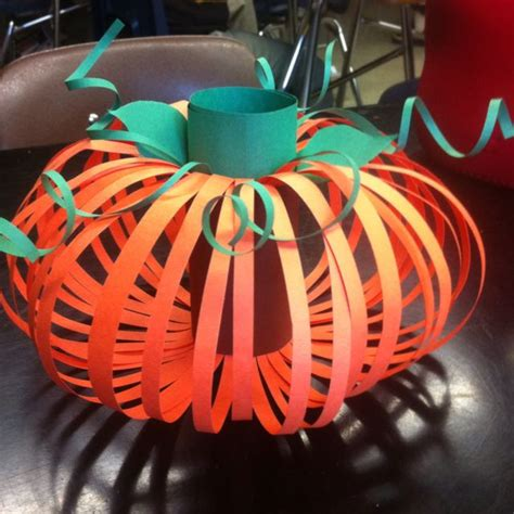 Thanksgiving Construction Paper Crafts - pumpkin made from a toilet paper roll and construction
