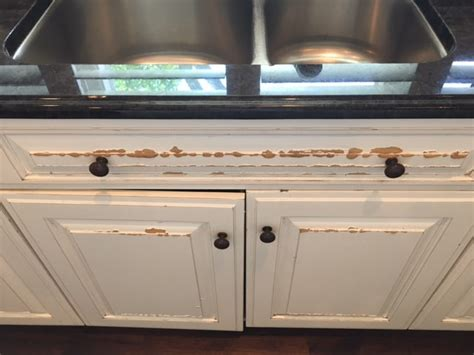 how to fix water damaged cabinets what to look for