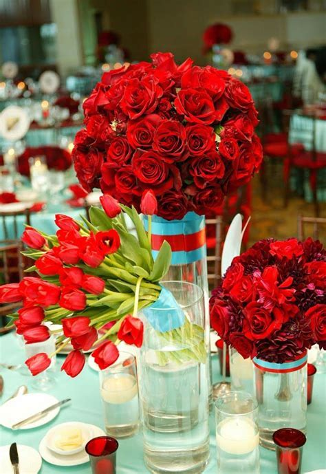 Roses and tulips centerpieces in red using various