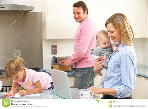 Family Busy Together In Kitchen Stock Images   Image: 24161774