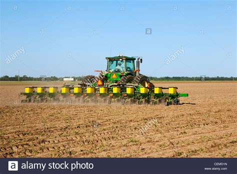 12 Row Planter by Agriculture A Deere Tractor And 12 Row Maxemerge