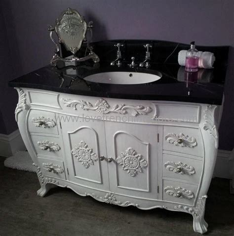 a bespoke sink vanity unit with solid marble top