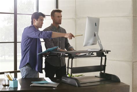 stand at your desk the best standing desks for your home or office business