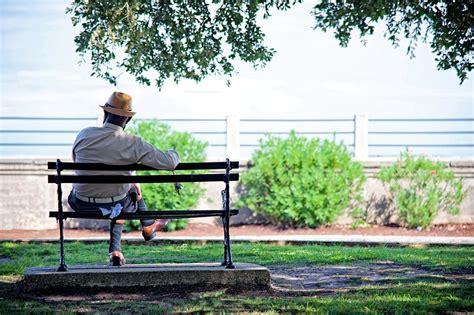 charleston battery bench man sitting on a bench at battery park charleston photograph by matt plyler