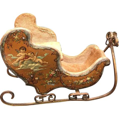 antique doll french miniature sleigh embossed cherub