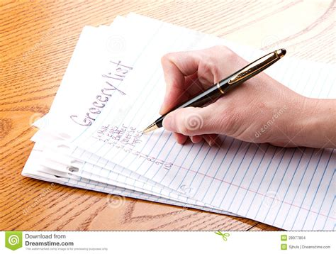 person writing on paper writing grocery list stock images image 28077804