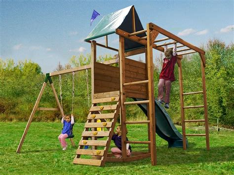 wooden swing climbing frame monkeyfort woodland wooden childrens climbing frame swing