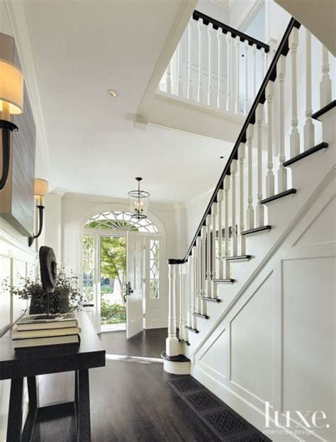 colonial interior design white dutch colonial revival entry luxe interiors