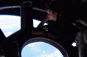 Mission Arm Chair Female Astronaut Looks Down At Earth From Window Of Her