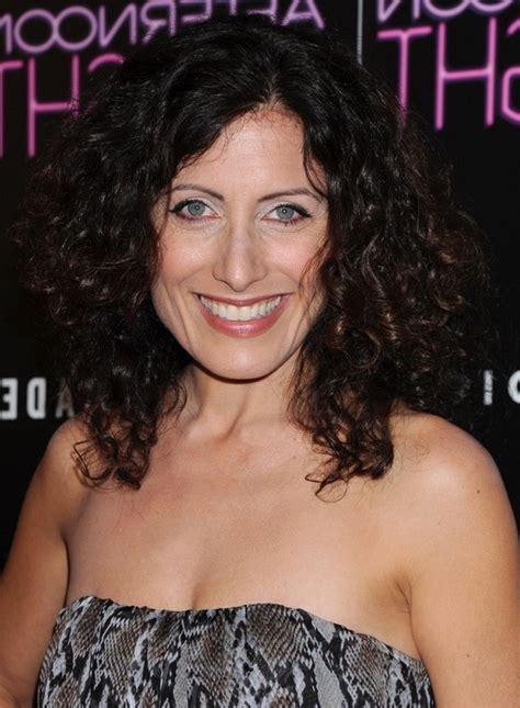 dark hair on women over 50 lisa edelstein dark long curly hairstyle for women over 50
