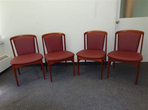 erik buch set of four teak dining chairs reupholstered in