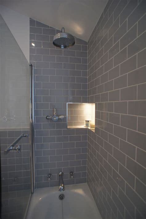 gray tile in bathroom these photos were sent in from an interior designer who