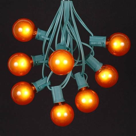 Orange G40 Globe Round Outdoor String Light Set On Green Novelty String Lights