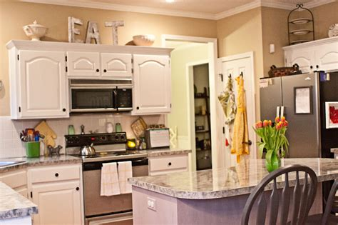 how to decorate top of kitchen cabinets pinterest decorating above kitchen cabinets with flowers