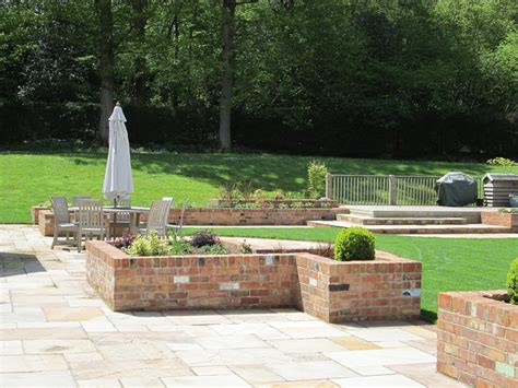 Brick Planters by Garden With Reclaimed Brick Planters Steps And Indian Sandstone Paving Simon Landscaping