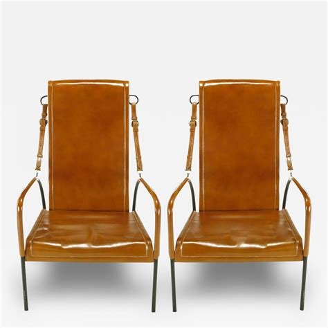 pair of custom leather and wrought iron lounge chairs